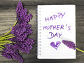 bouquet and notepad with words `happy mother`s day` Royalty Free Stock Photo