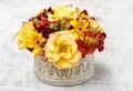 Bouquet of orange roses and autumn plants in vintage ceramic vas Royalty Free Stock Photo