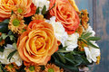Bouquet of orange roses and ivory carnation flowers Royalty Free Stock Photo
