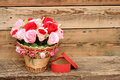 Bouquet paper flower in a basket with gift box Royalty Free Stock Photo
