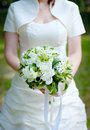 Bouquet with peonies in hands of bride Royalty Free Stock Photo