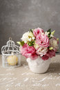 Bouquet of pink eustoma flowers and scented candle Royalty Free Stock Photo