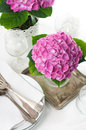 Bouquet pink hydrangeas vintage cutlery festive table closeup Stock Images