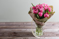 Bouquet of pink peony tulips on a wooden background. Spring flowers. Mother`s Day background. Royalty Free Stock Photo