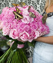 Bouquet of pink roses with live butterflies in female hands Royalty Free Stock Images