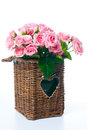 Bouquet of pink roses in a wicker basket Stock Photography