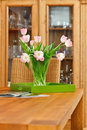 Bouquet of pink tulips flowers in glass vase Stock Photo