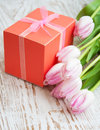 Bouquet pink tulips gift box table Stock Image