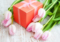 Bouquet pink tulips gift box table Royalty Free Stock Photo