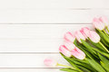Bouquet of pink tulips on white wooden background Royalty Free Stock Photo