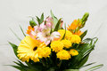 Bouquet of pink, white, orange and yellow flowers. Many different blossoms. Big gerbera bloom. Blooming chrysanthemum, white fabri Royalty Free Stock Photo