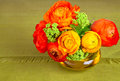 Bouquet of ranunculus flower beautiful in an yellow vase Stock Photo