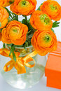 Bouquet of ranunculus flowers close up orange in glass vase Royalty Free Stock Photos