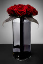 Bouquet of red roses in glass vase Royalty Free Stock Photo