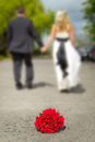 Bouquet of red roses with married couple Stock Photos