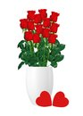 Bouquet  of red roses in white vase and red hearts closeup Royalty Free Stock Photo