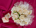 Bouquet and rings for Valentine\'s Day Stock Images