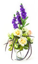 Bouquet of rose and lavender in glass vase on white Royalty Free Stock Photos