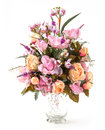 Bouquet of rose and narcissus in glass vase on white Royalty Free Stock Images