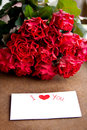 Bouquet of roses for beloved woman red and postcard Stock Images