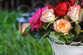 Bouquet of roses garden party lanterns on grass in the background Royalty Free Stock Photo