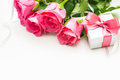 Bouquet of roses and gift box on white background Royalty Free Stock Image