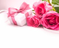 Bouquet of roses and gift box on white background Royalty Free Stock Photography