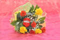 Bouquet of roses and a gift on red background Royalty Free Stock Images