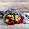 Bouquet of roses on the table. Multicolored roses Royalty Free Stock Photo