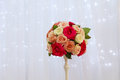 Bouquet of roses in a vase on the background of a silk curtain Royalty Free Stock Photo