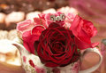 Bouquet of roses with wedding rings Stock Photography