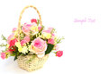 Bouquet of roses in white basket with space for text Royalty Free Stock Image