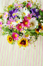 Bouquet of simple flowers on the table Stock Photos