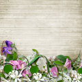 Bouquet of spring flowers on a wooden vintage background
