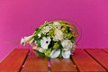 Bouquet on table with flashy background white roses a wooden a pink colored Stock Photos