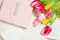 Bouquet of tulips,  gift box and blank greeting card Royalty Free Stock Photo