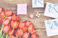 Bouquet of Tulips on Wooden Table with Presents Royalty Free Stock Photo