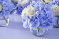 Bouquet white blue flower vase glass decoration dining table Royalty Free Stock Photography