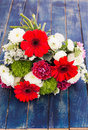 Bouquet of white, pink and red flowers on a wooden surface Royalty Free Stock Images