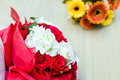Bouquet of white and red roses yellow flowers on table Royalty Free Stock Image
