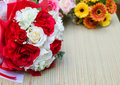 Bouquet of white and red roses yellow flowers on table Royalty Free Stock Photography