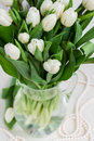 Bouquet of white tulips fresh in vase on table Stock Photography