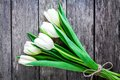 Bouquet of white tulips on a rustic background Royalty Free Stock Photo