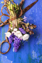 Bouquet of wildflowers and old rusty scissors top view on over blue wooden background Stock Image