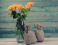 Bouquet of yellow roses in glass vase Royalty Free Stock Photo