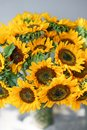 Bouquet of yellow sunflowers , flower in vase on old vintage table. Room morning. Gray background. Colors of autumn and Royalty Free Stock Photo