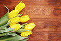 Bouquet of yellow tulips beautiful on a wooden board Stock Images