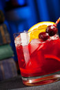 Bourbon cocktail with cherry bitter and orange Stock Image