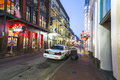 Bourbon street in twilight with police car new orleans louisiana july neon lights the french quarter on july tourism provides a Stock Photos