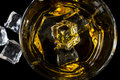 Bourbon whiskey with ice on a black background Royalty Free Stock Photography